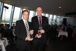 Dominik Raasch (links) und Jörg Langenberg von der adp Gauselmann GmbH freuen sich über die Auszeichnungen für Merkur Infotainment.(Foto: Gauselmann-Gruppe)