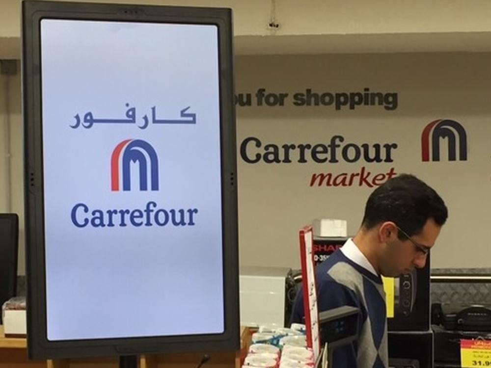 Amscreen Screen an der Kasse eines jordanischen Carrefour (Foto: Amscreen)