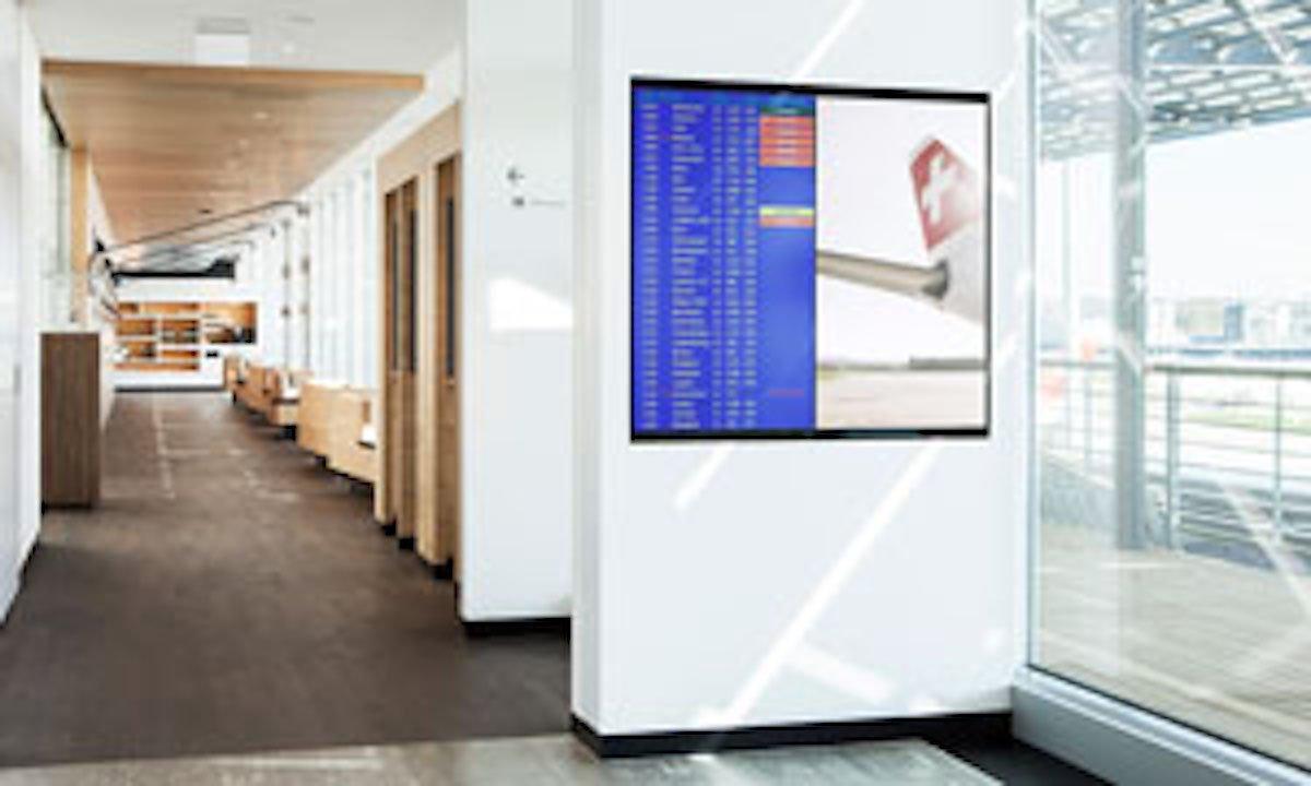 Screen in einer Lounge der SWISS (Foto: SWISS)