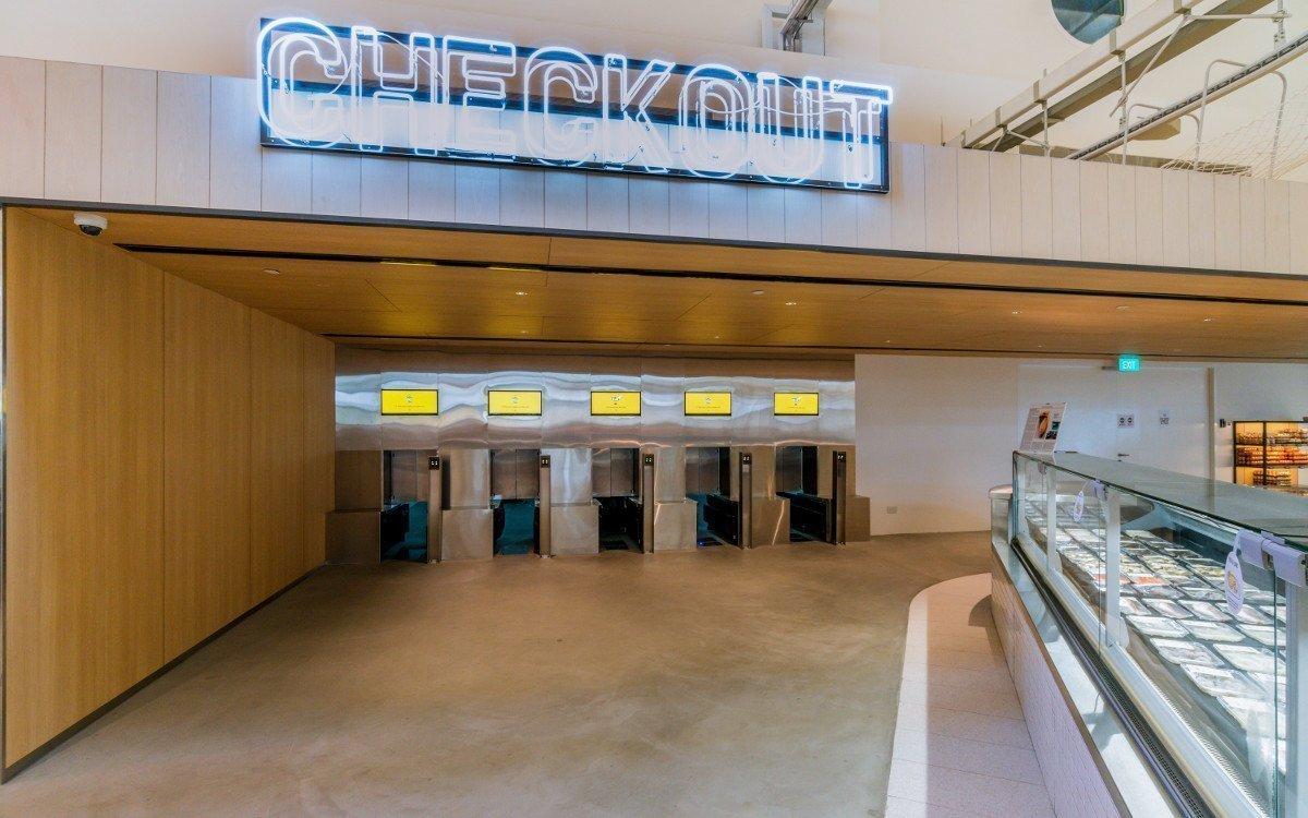 Checkout für Einkaufswagen - hier werden die Einkaufswagen eingecheckt, der Einkauf gescannt, verpackt und zwischengelagert (Foto: Honestbee)