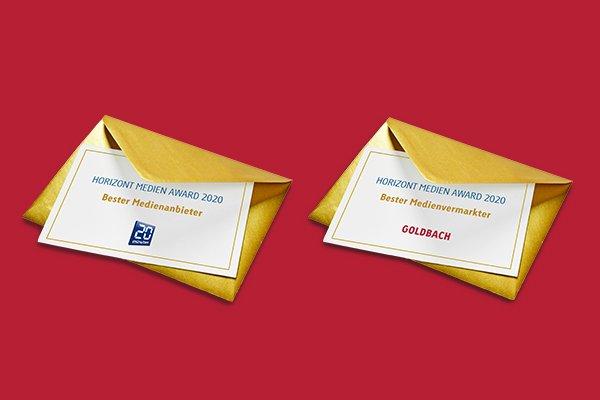 Die Siegerumschläge der TX Group: Goldbach wird bester Medienvermarkter, 20 Minuten bester Medienanbieter (Foto: Goldbach)